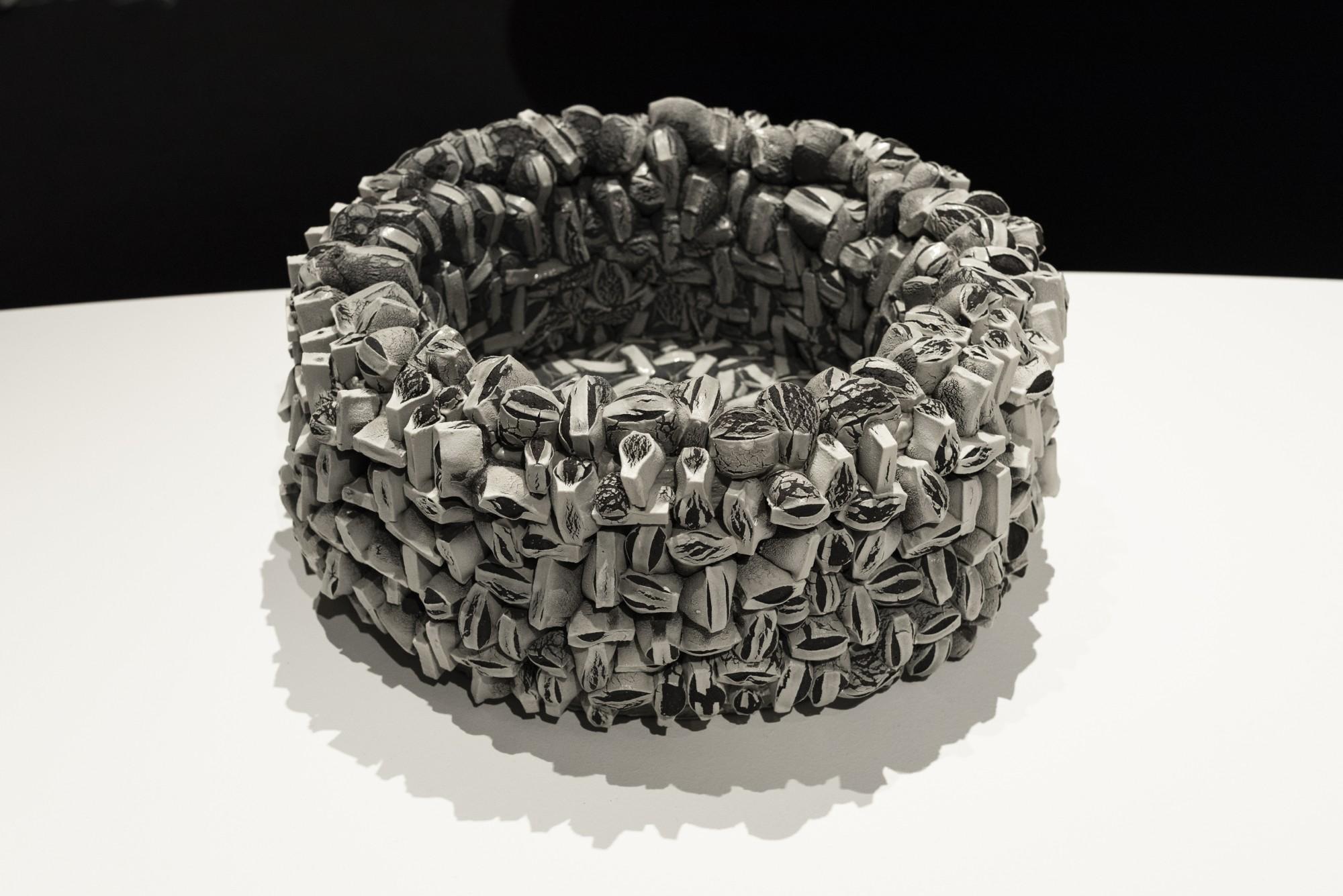 d209fa9ecb244 courtesy of  Officine Saffi Ceramic sculpture Rafael Pérez creates a woven  basket-like structure from black earthenware covered in white porcelain  strips.